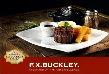 Fillet steak and hand-cut chips on square plate on butchers block